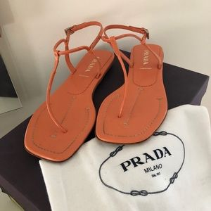 Prada Flat Leather T-Strap Sandals in Coral